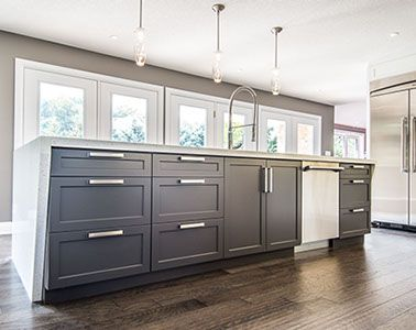 Dark Charcoal Shaker Doors Are Brightened Up With Brush Nickel Handles And Waterfall Quartz Counterto Kitchen Facelift House Color Schemes Contemporary Kitchen