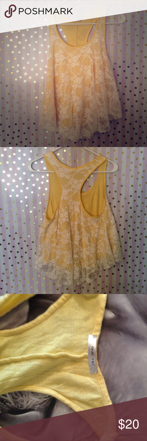 Lovely yellow and cream lace crop top The material for the yellow is so soft and the cream lace is as well. It's not the type that's irritating and scratchy. It's a half shirt or crop top and it's only been worn one. Mai Tai Tops Crop Tops