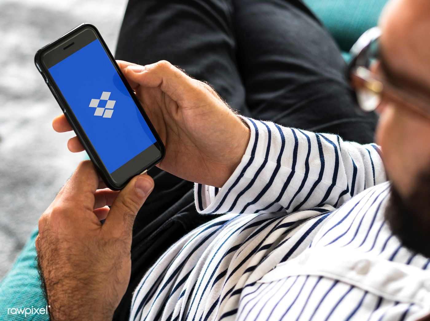 A person using dropbox application on a mobile phone