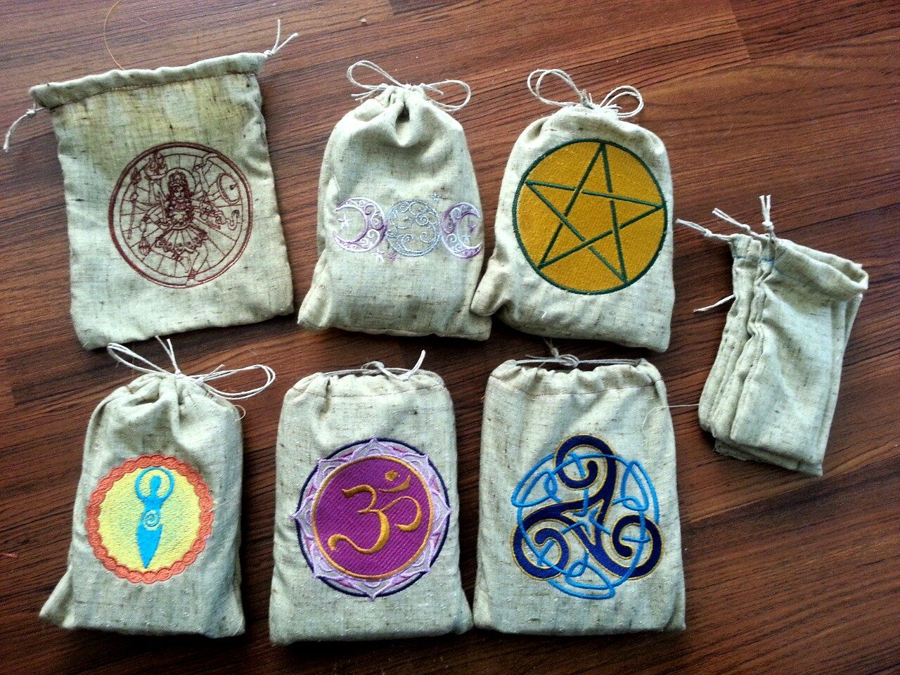 Spell/tarot bags for my travel trip across the country.  The large bags can be for tarot cards, stones, or used as spell bags.  The small bags can be for spells or for herbal baths.