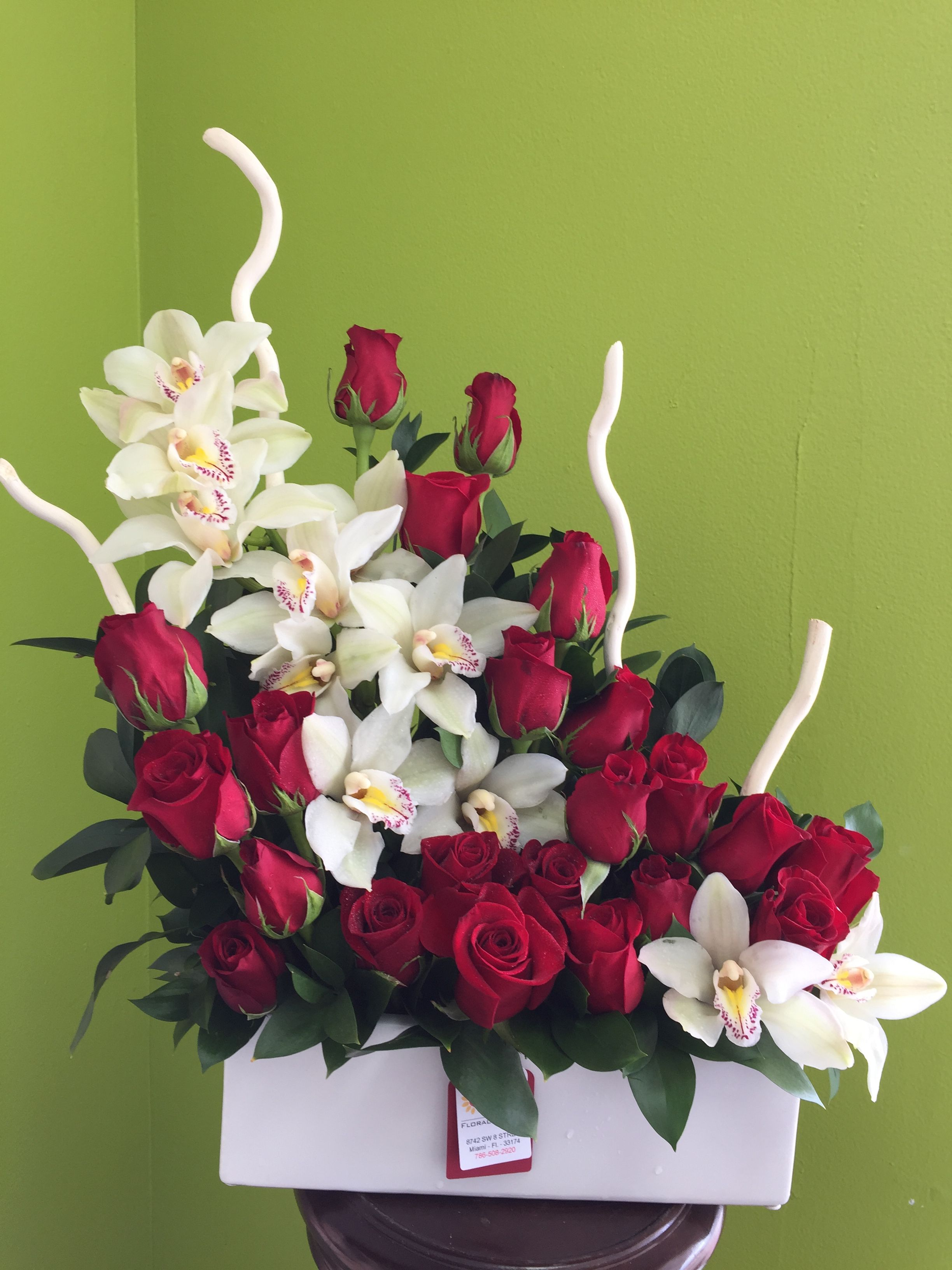 White Orchids And Red Roses