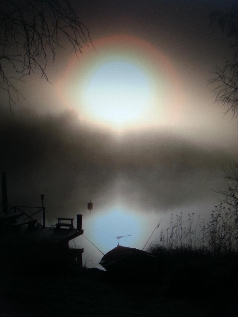 Stunning Halo-phenomenon captured by the night fisher, Kuopio, Finland - Mari Myllynen / Kesäkuvat / yle.fi