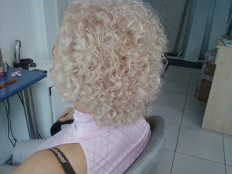 big curls in shorter perm style