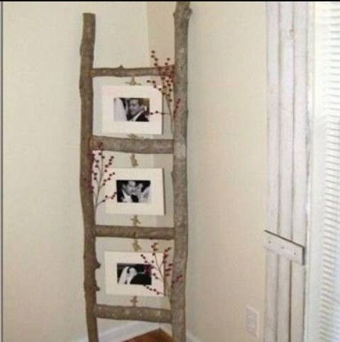 An old ladder into a stylish frame stand....easy to make..when bored ...