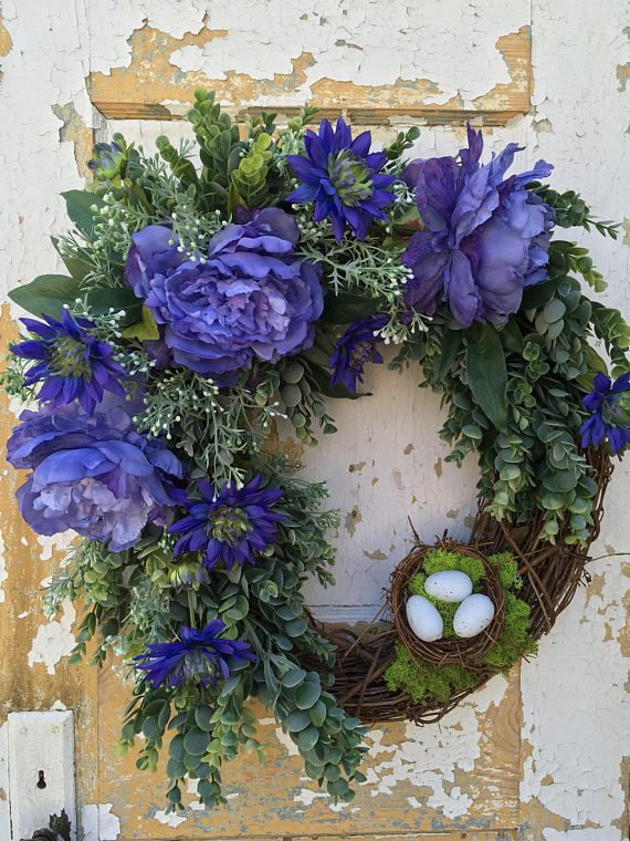 Photo of Spring wreath with nest, purple wreath