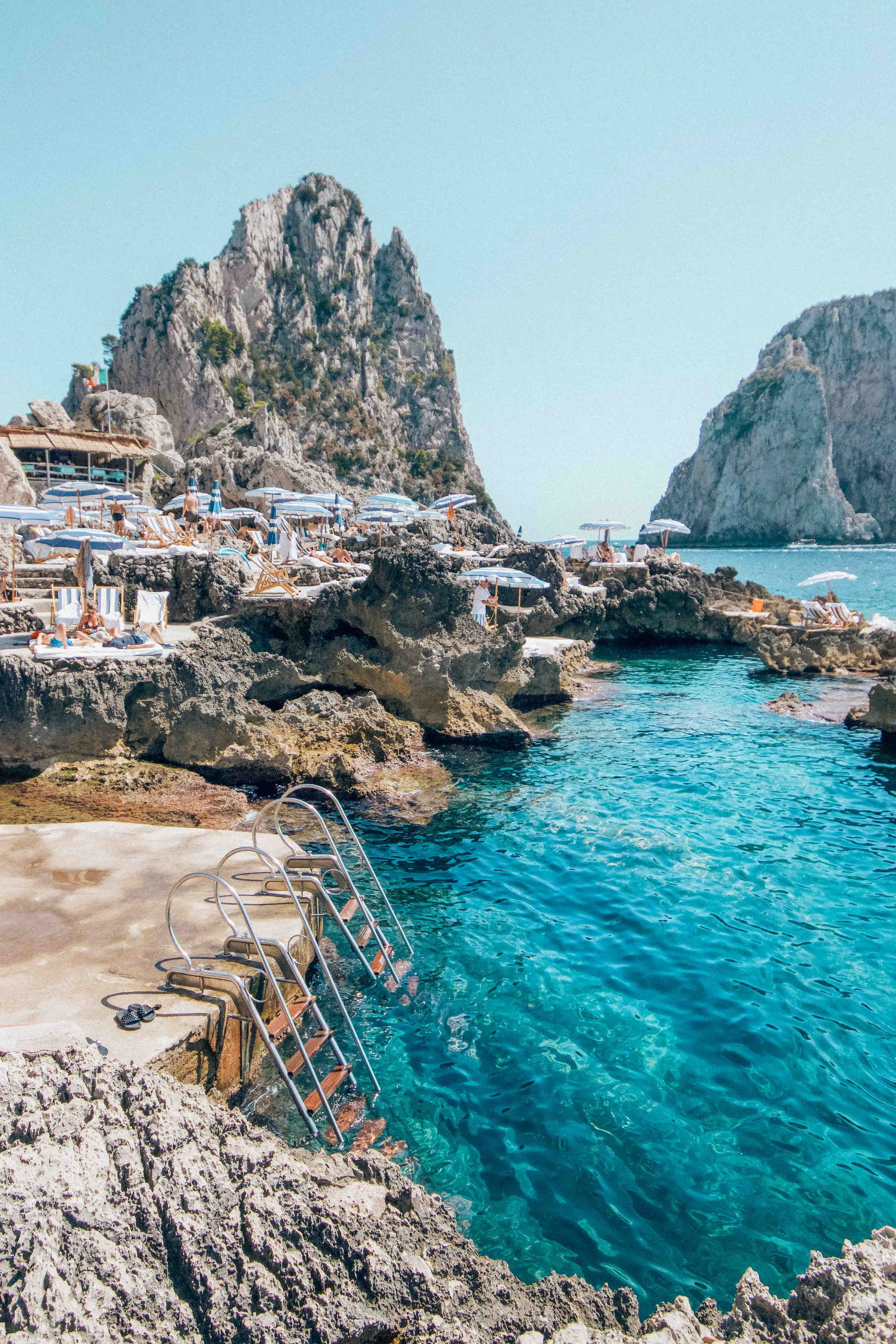 If You're Waiting for a Sign to Plan a Trip to Capri, This Is It | You'll be hard-pressed to find a better vacation spot than Capri. Famous for its stylish shopping scene, Michelin-starred cuisine and, of course, that unbelievable blue sea, the Italian island is everything a glamorous getaway should be. | Photo: Sarah Gordon