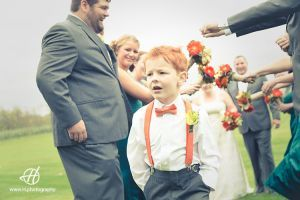red hair kid having fun at his uncle wedding  # wedding at Orchard # fall wedding  # fun wedding party  Doru Halip for www.h.photography