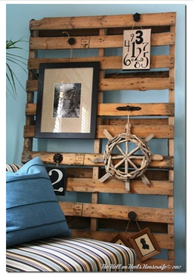 Pallets Leaned Against Concrete Wall To Hand Pictures