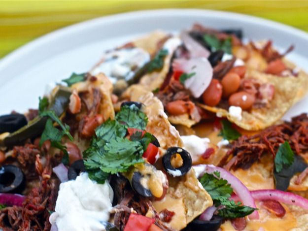 Delicious nachos with beef barbacoa and pickled red onions.