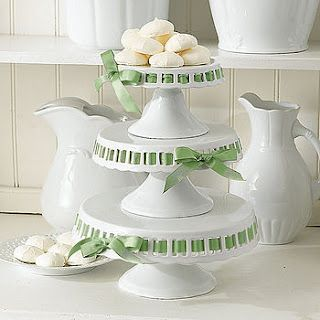 Cake stands with a coloured ribbon..so cute!!