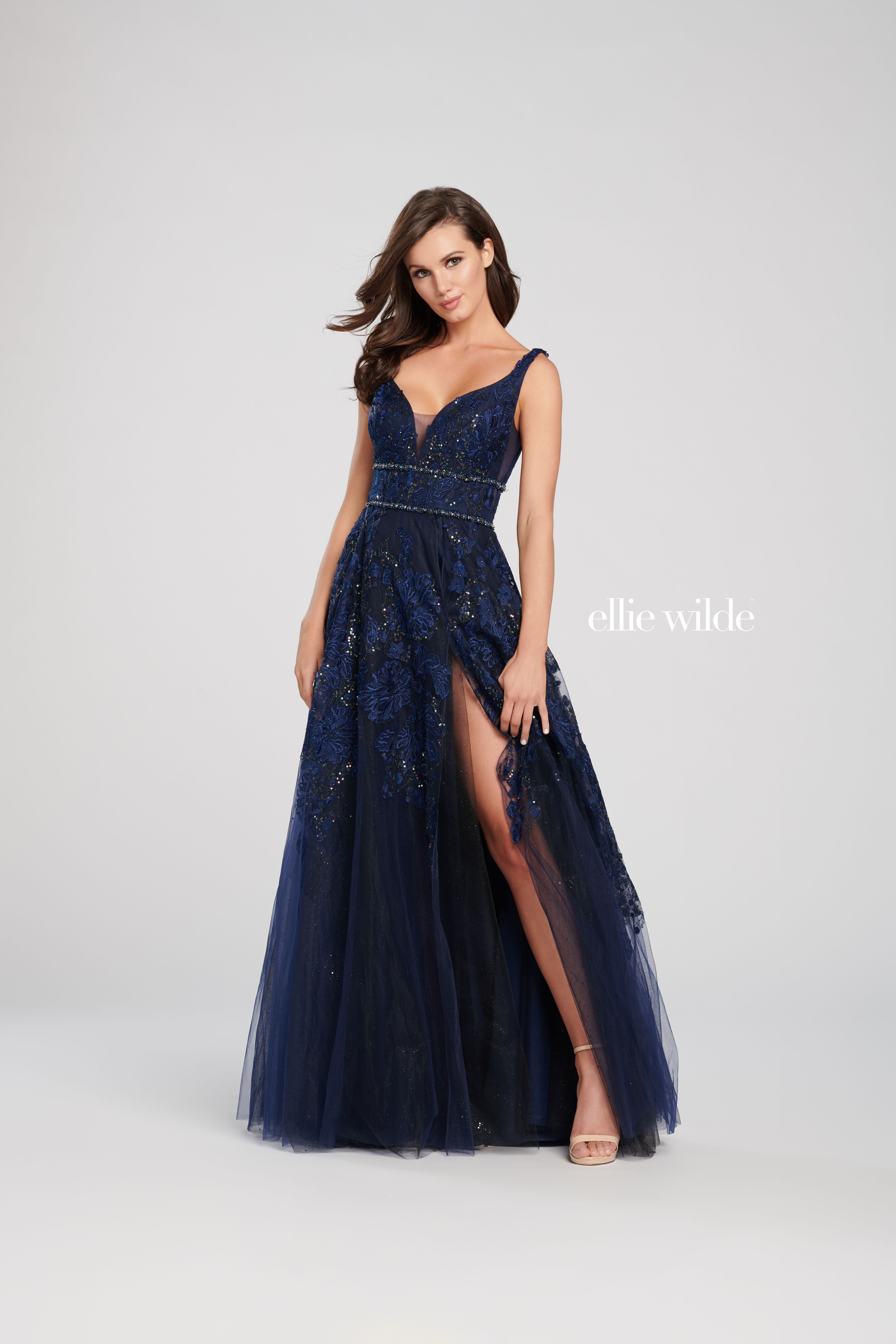 49850324045605 Ellie Wilde EW119035 - Gorgeous from head to toe, this sleeveless sequin  and sparkle tulle A-line gown adorned with embroidered lace features a  plunging ...