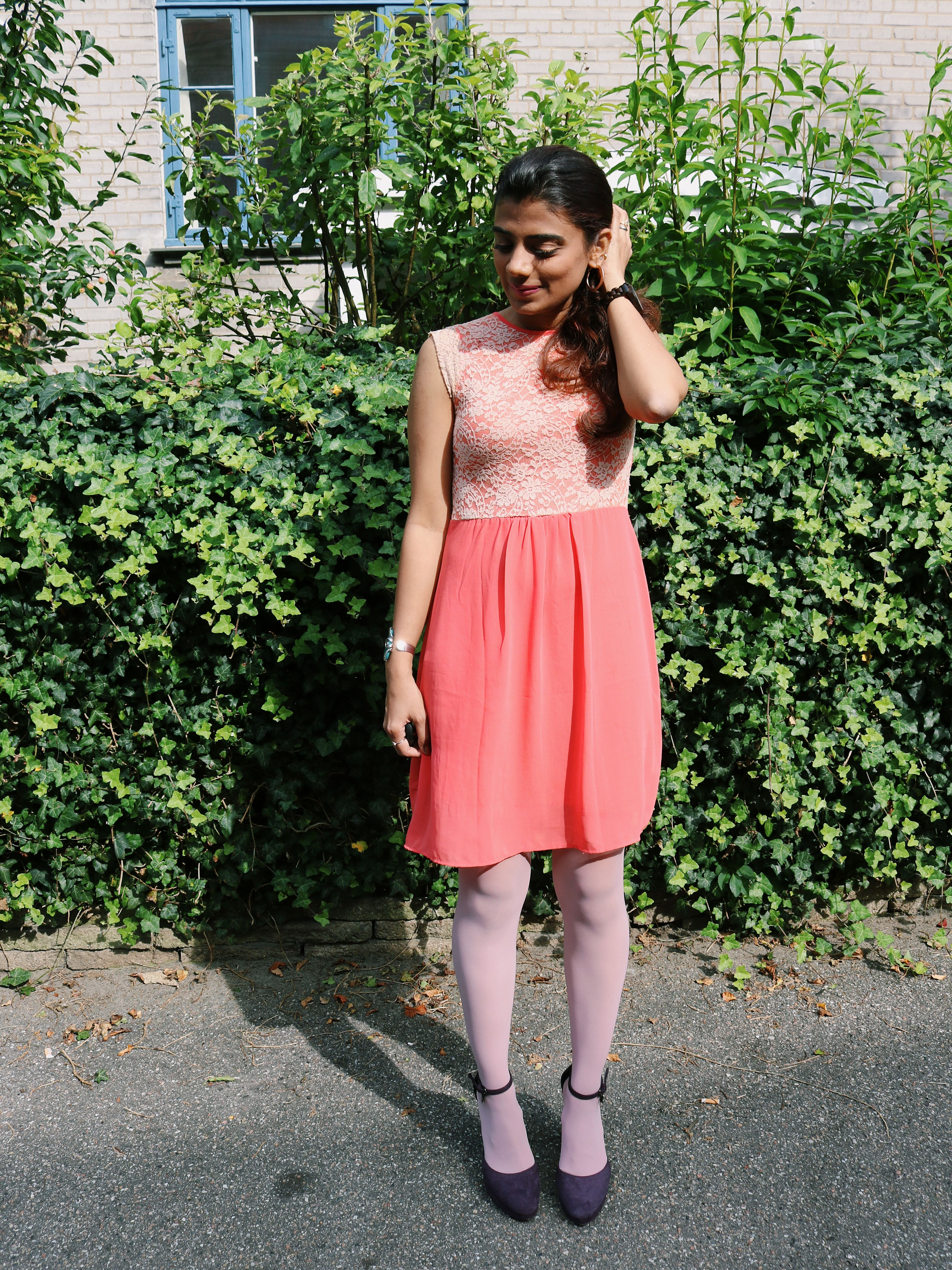 Color Blocking Orange Dress With Pink Colored Tights And Purple
