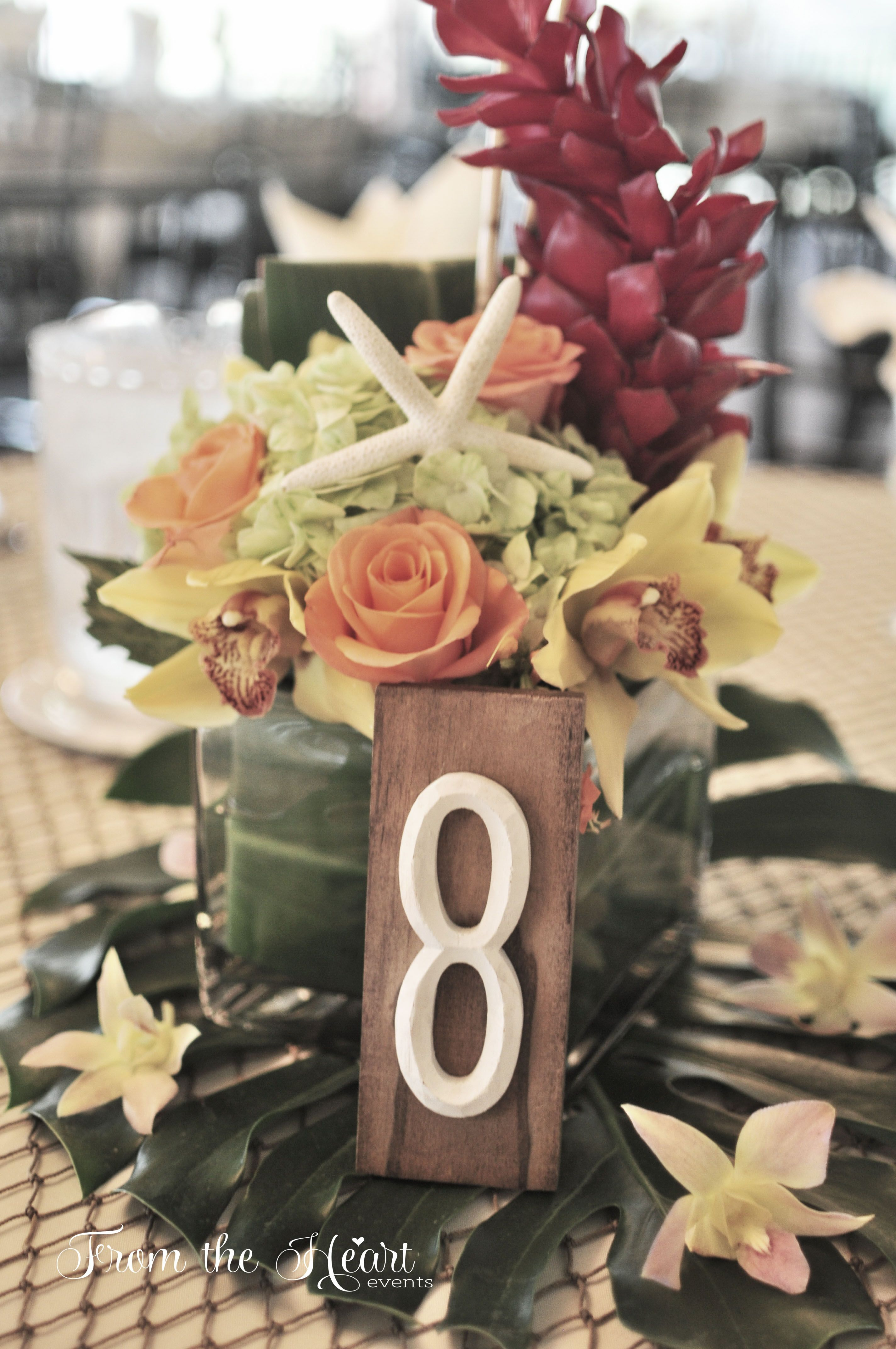 Tropical centerpieces using folded ti leaves green
