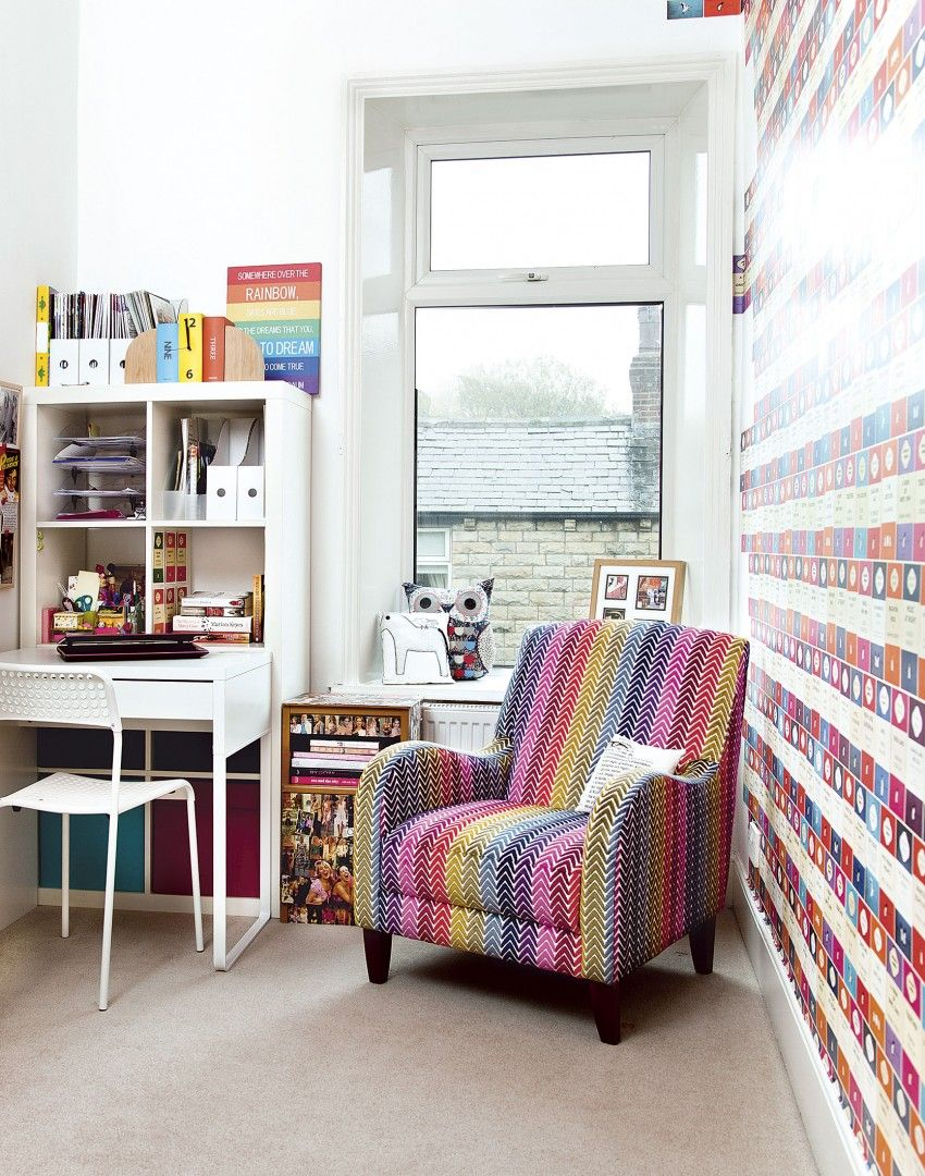 Colourful book print wallpaper in this home office not only ties in ...