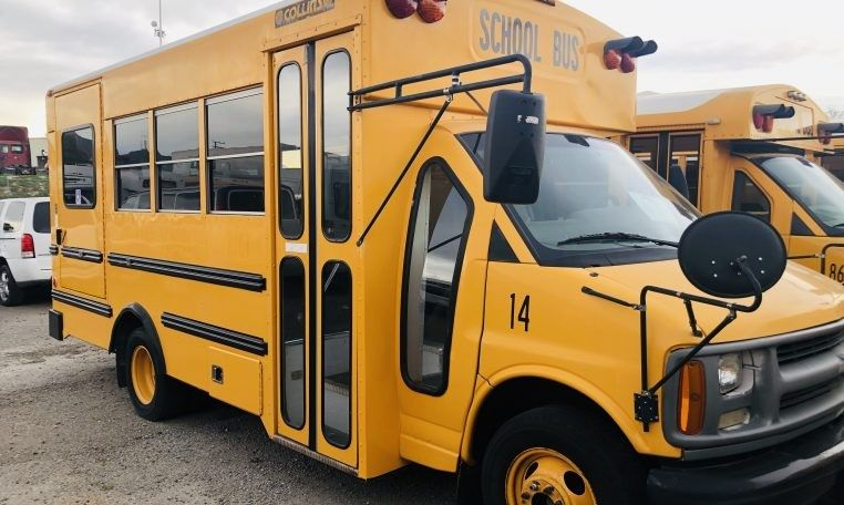 Buses and cars image by evan larson school bus bus