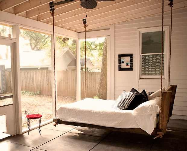 Porch Swing Bed In An Outdoor Screened