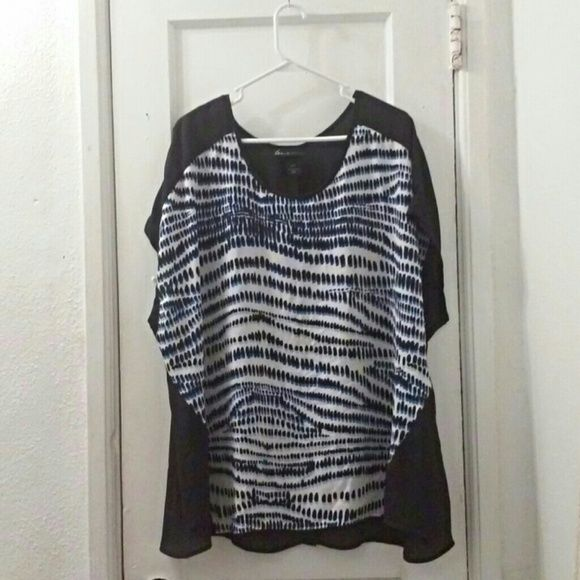 Cute Patterned Lane Bryant Top Never worn, only modeled and tried on by my friend featured in the photos. The back is sheer and you can faintly see through it. There is a slit on the back near the bottom, shown in the third photo. Willing to negotiate, make me an offer!  Feel free to ask questions! Lane Bryant Tops