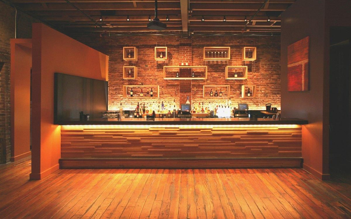 Bar face wood slat wall panels projecting rail for Wooden bar design