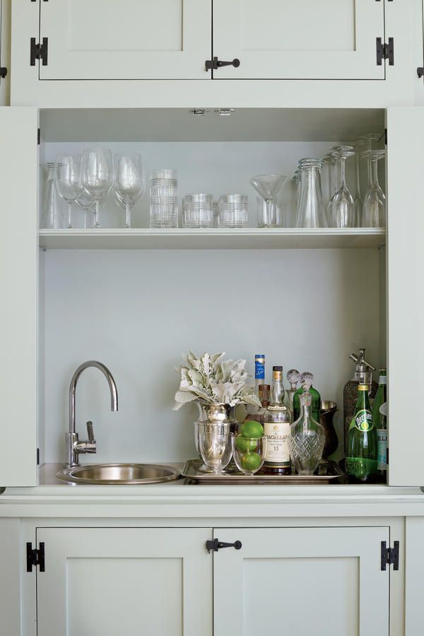 Two Freestanding Cabinets Stow Everyday Necessities And Hold A Ready For Entertaining Wet Bar They Re Very True To That Period When Kitchens Used Actual