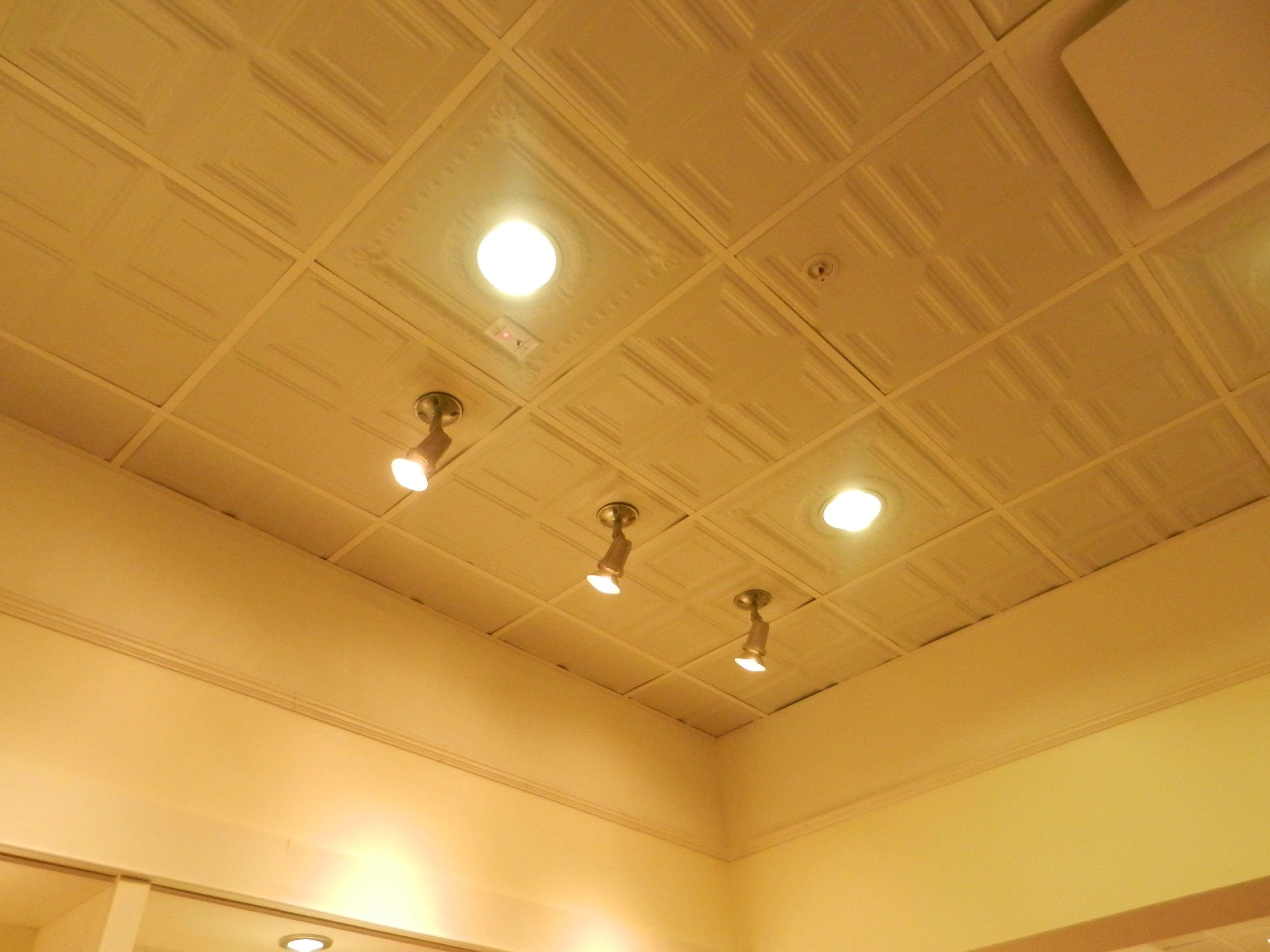 Ceiling tiles with recessed lighting adjustable down