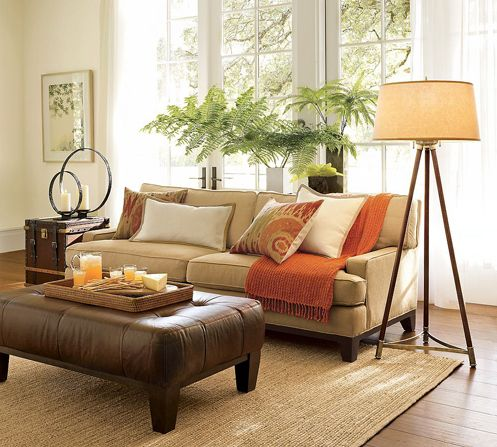 Beige and cream living room with rust red accents for Brown green and cream living room ideas