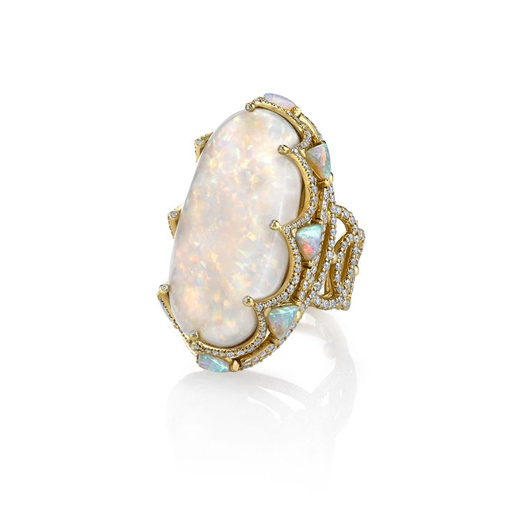 ROYAL RING 18K Yellow gold ring featuring a 42 ct. Opal with 4.28 ctw., Opal trillions and 2.05 ctw. of Diamonds. Erica Courtney®