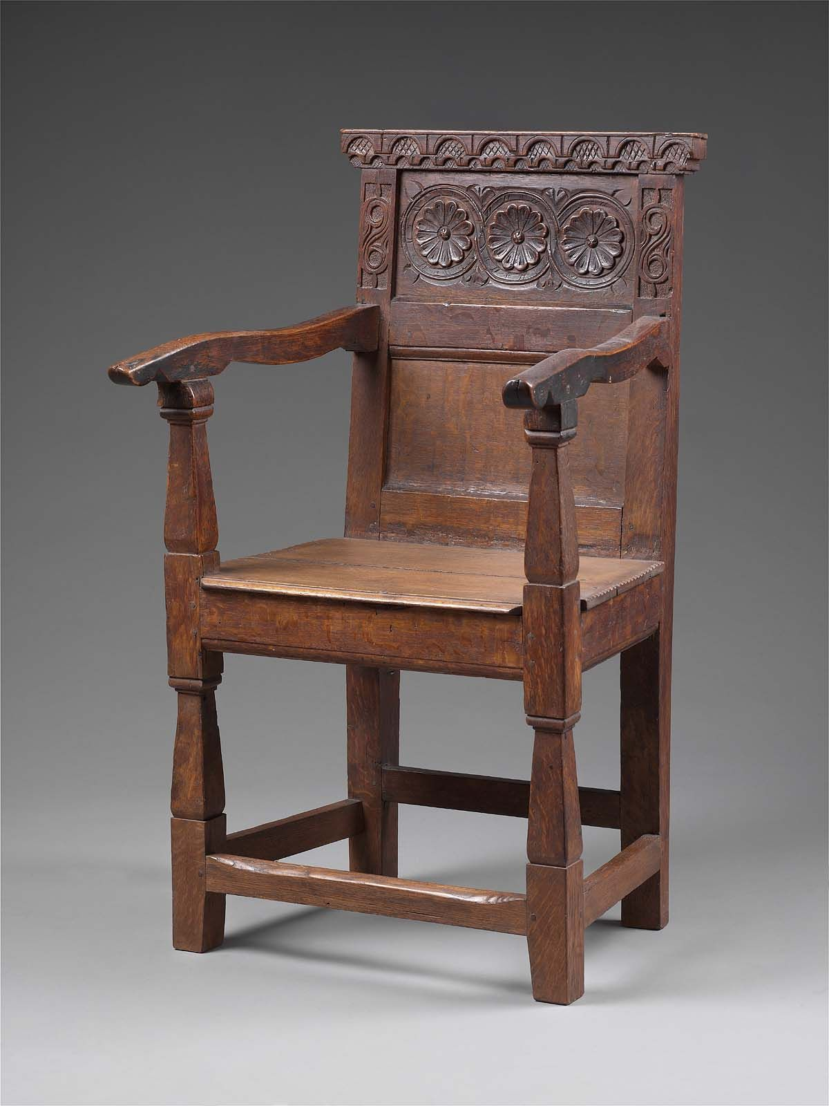 A Wainscot Chair, With The Upper Panel Of The Two Paneled Back Carved With  A Bold Guilloche Containing Three Rosettes. The Guilloche Bands Are Sharply  ...