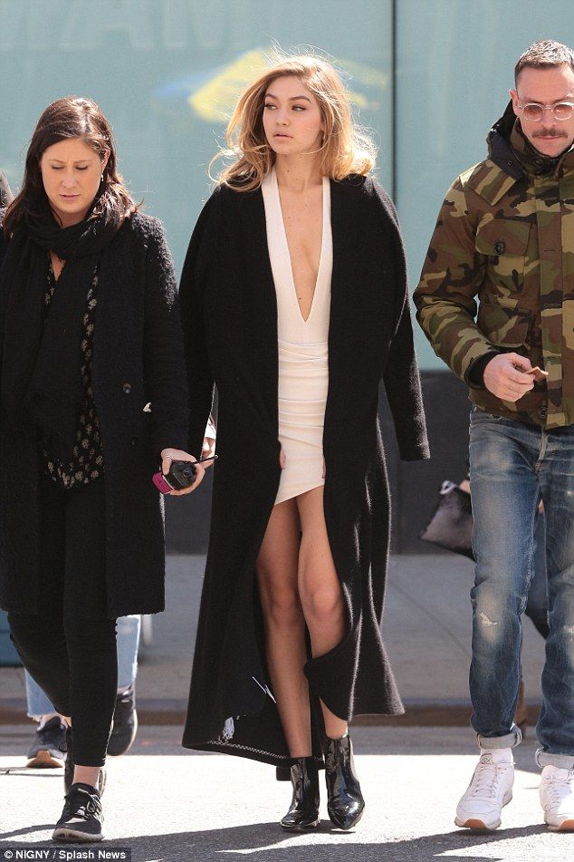 Gigi Hadid looks glamorous in plunging pink dress and black coat ...