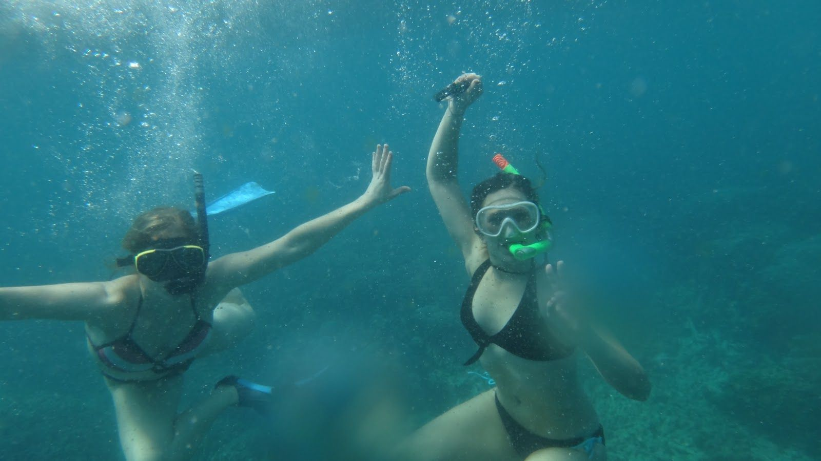 Three girls are horsing around near the sea bottom snorkeling a relationship between yoga and free diving xflitez Choice Image