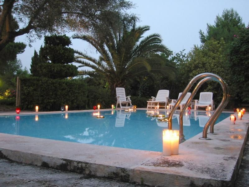At the end of the evening, create a lighting display as part of your pool