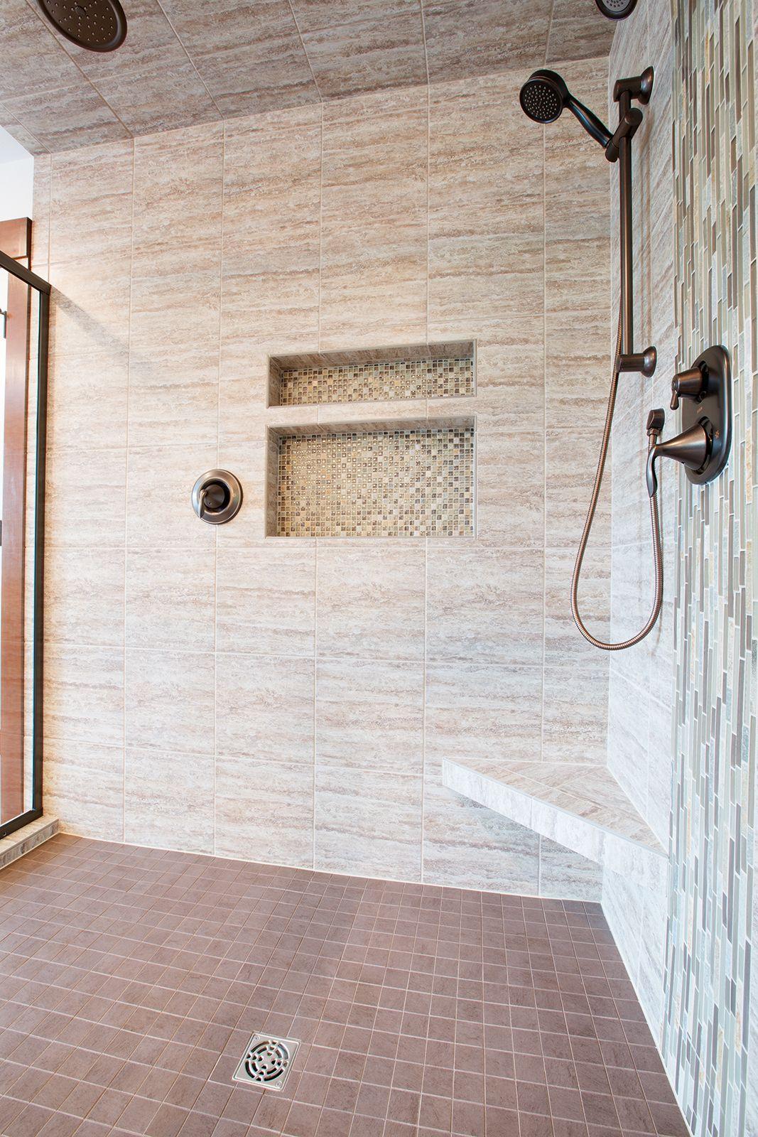 Beautiful fully tiled shower, walls, floor & ceiling. Moen ORB rain shower head and hand held shower head. Built in tile bench and shampoo shelf.