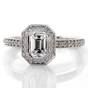 This modern ring has a lovely, narrow band with micro pave. The center diamond is an emerald cut surrounded by a micro pave halo. The band is a Euro Shank.   Emerald Bezel Elegante from Knox Jewelers  #halo #emeraldcut #euroshank