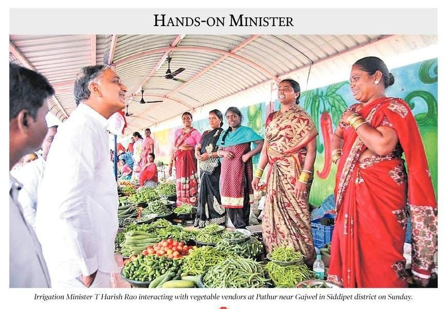 Irrigation minister T Harish Rao interacting with Vegetable vendors