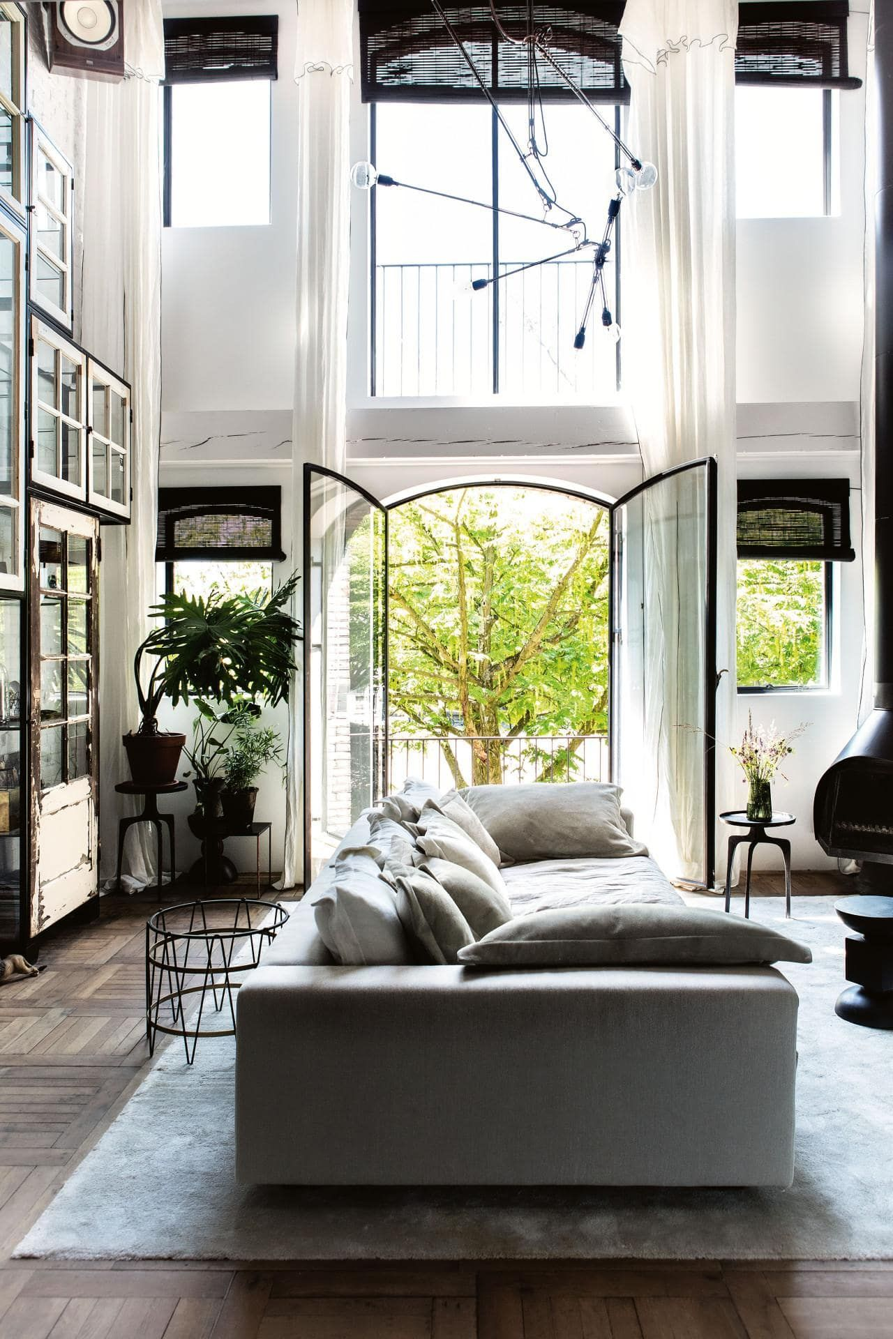 House Tour A Former Amsterdam Warehouse Overflowing With Vintage Treasures Vintage Apartment House Interior Living Room Inspiration