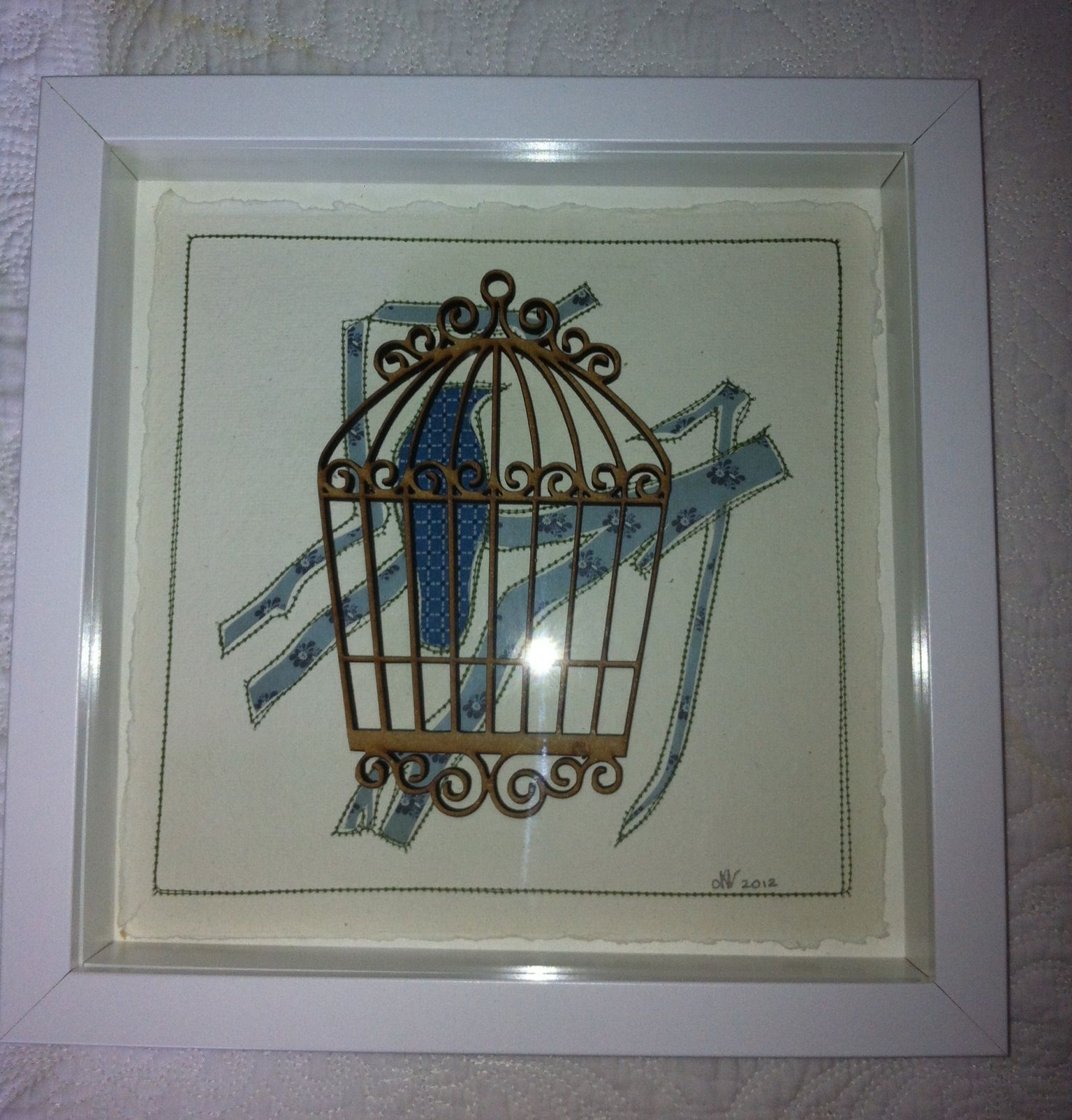 Laser cut bird cage, hand cut paper and stitch - artist Laura Drayson
