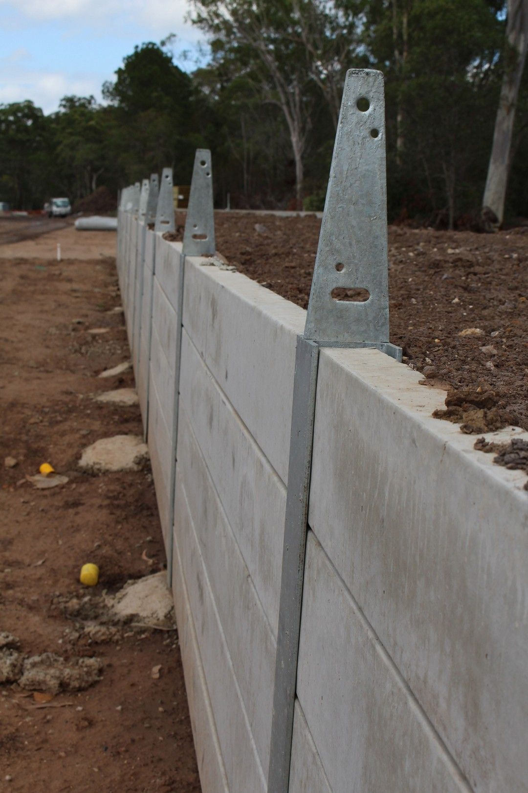 Diy Cinder Block Retaining Walls With Rebar And Concrete In 2020 Concrete Fence Posts Wood Fence Wood Fence Post