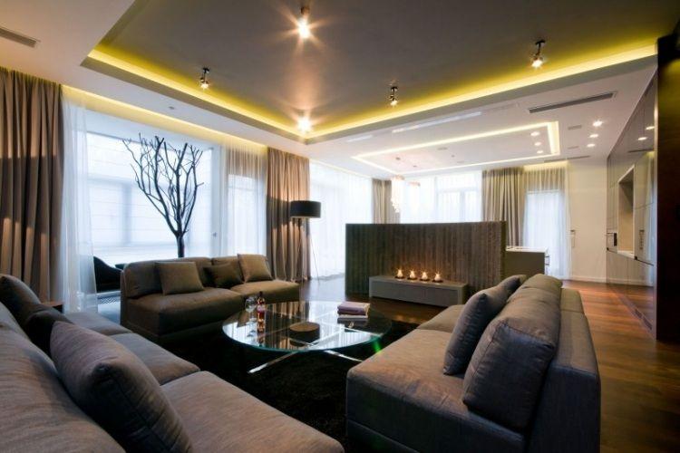 graue wohnzimmerm bel und runder glas couchtisch