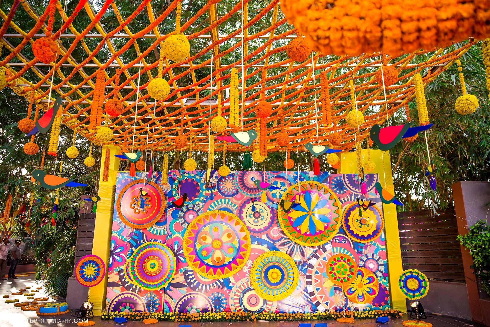 Mehndi Backdrop Diy : Vibrant colors backdrop entry photobooth at the mehndi function