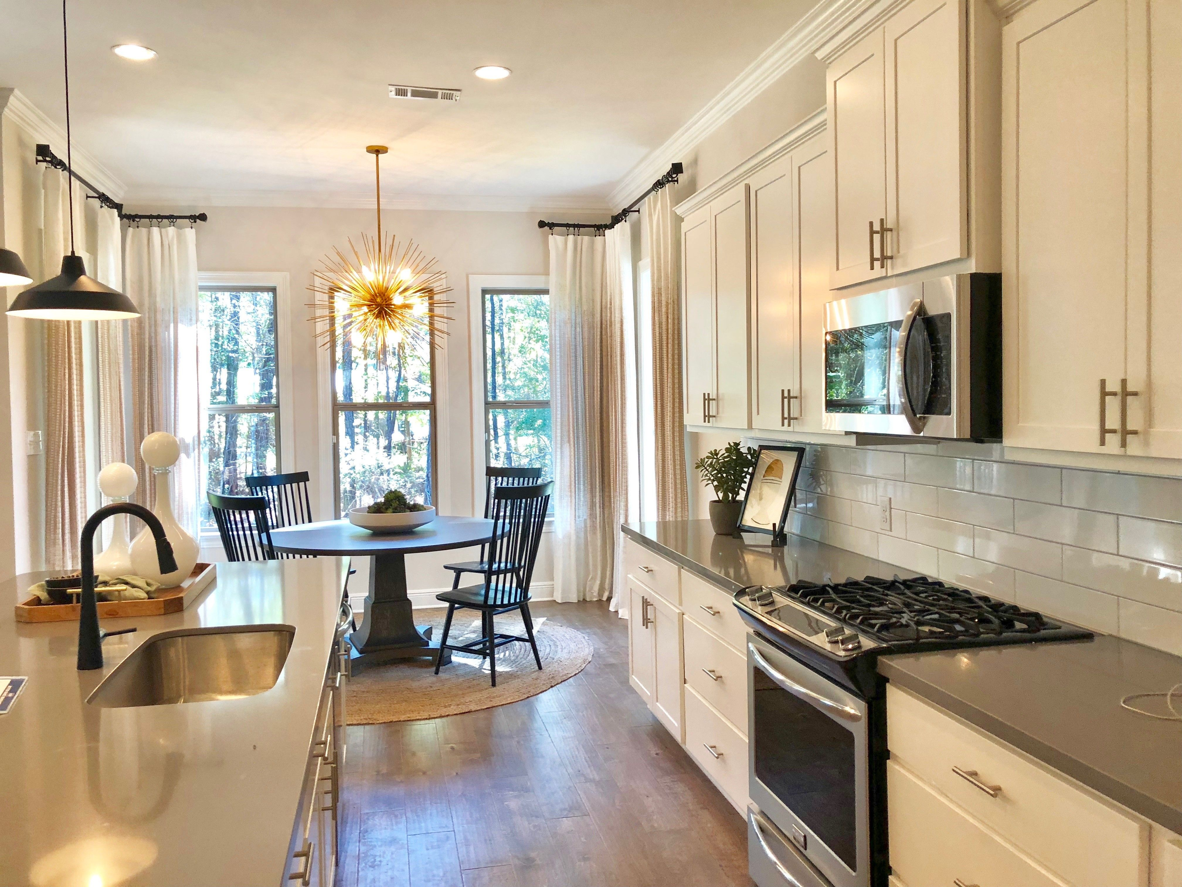 What S For Dinner This Kitchen Is The Chef S Dream With Large Kitchen Island Gas Stove And Plenty Of Ca Large Kitchen Island New Home Communities New Homes
