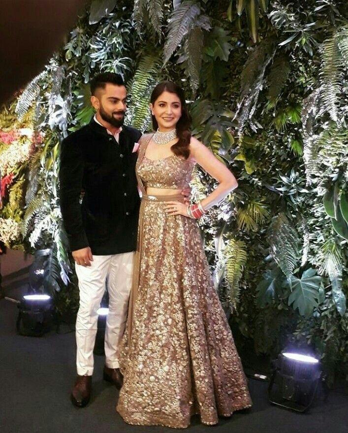 Couple at Mumbai reception Indian reception dress