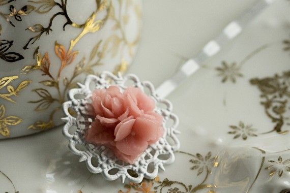 http://www.etsy.com/listing/70962785/pink-flower-bobby-pin-white-filigree?ref=sr_gallery_18&ga_search_query=pink+flower&ga_view_type=gallery&ga_ship_to=GB&ga_noautofacet=1&ga_page=4&ga_search_type=handmade&ga_facet=handmade%2Faccessories