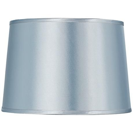 A pale blue satin drum lamp shade with a chrome finish spider fitter and silver piping
