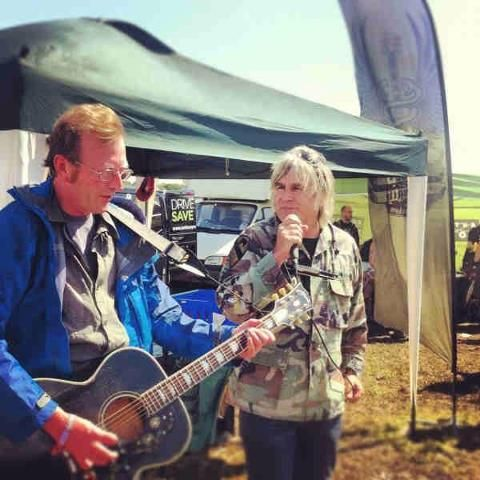 Mike Peters and Bruce Watson at the Love Hope Strength Foundation stall at the Isle of Wight Festival 2012
