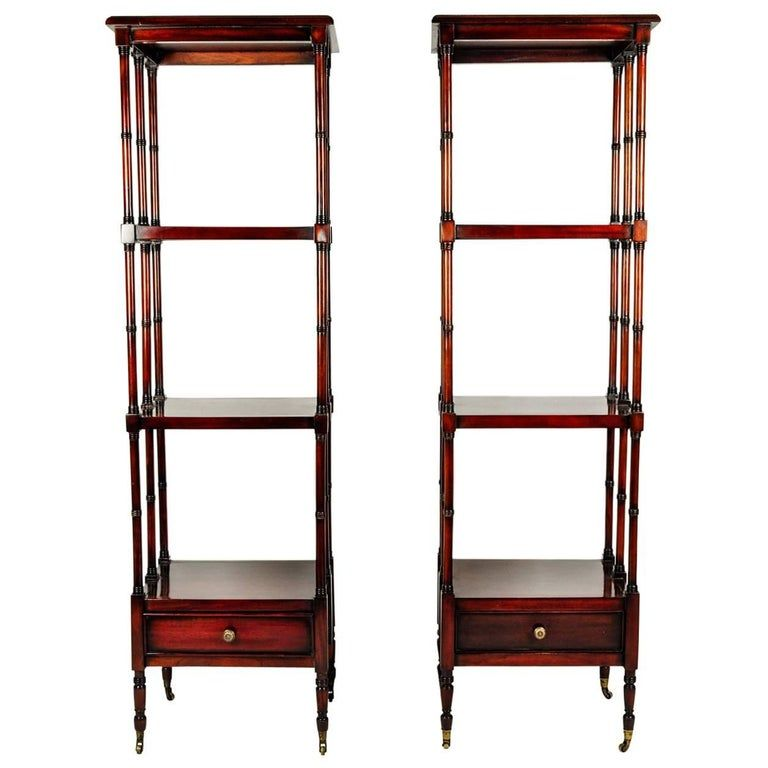 Vintage pair solid mahogany wood display shelves / etageres with lower bottom drawer. Both pieces are in excellent vintage condition. Minor wear consistent with age / use . Each etagere / shelve measure 61 inches high x 18.5 inches width x 16 inches deep.