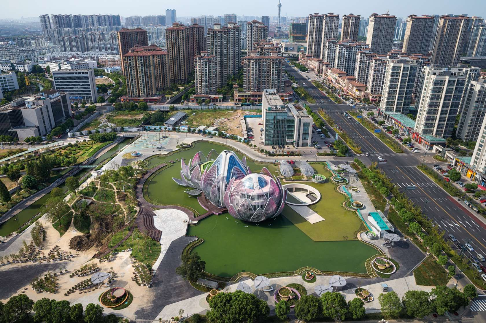 Chinas latest bizarre building is a giant ethereal lotus flower the lotus exhibition center is an icon for the city of wujin conceived as an addition to an existing underground building with a lake top the center is a izmirmasajfo