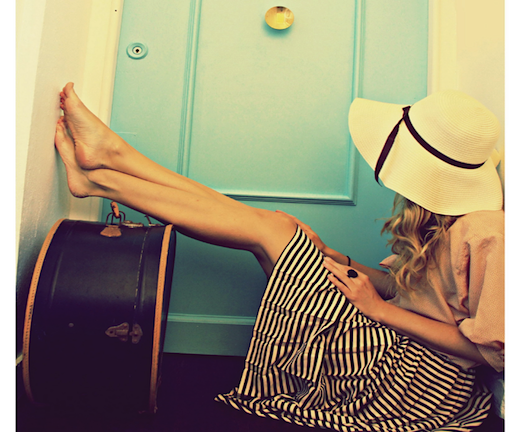 suitcases, stripes, and floppy hats