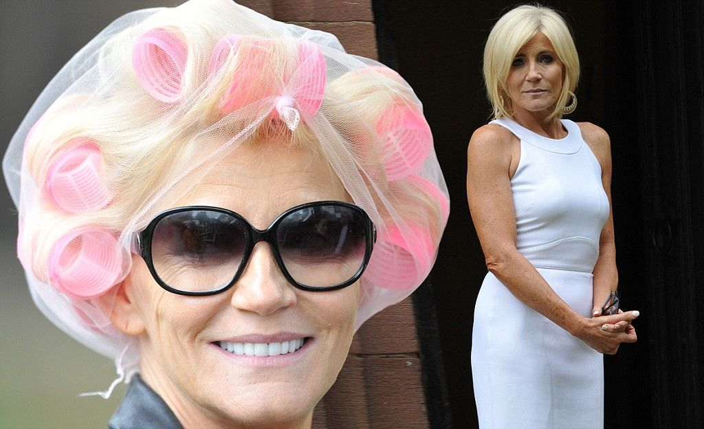 The perfect curl! Michelle Collins arrives on Coronation Street set with her hair in rollers before revealing her perfectly coiffed 'do to f...
