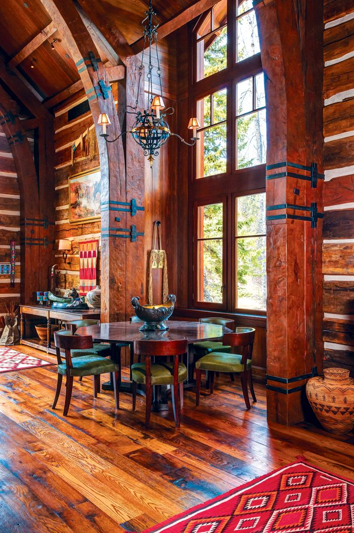 This post and beam homes traditional rustic architecture frames a collection of western art and antiques and native american artifacts