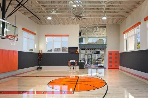 Charcoal Gray And Orange Padding Create A Safe Border Around The Polished Floor Of This Indoor Basketbal Home Basketball Court Basketball Room Basketball Floor