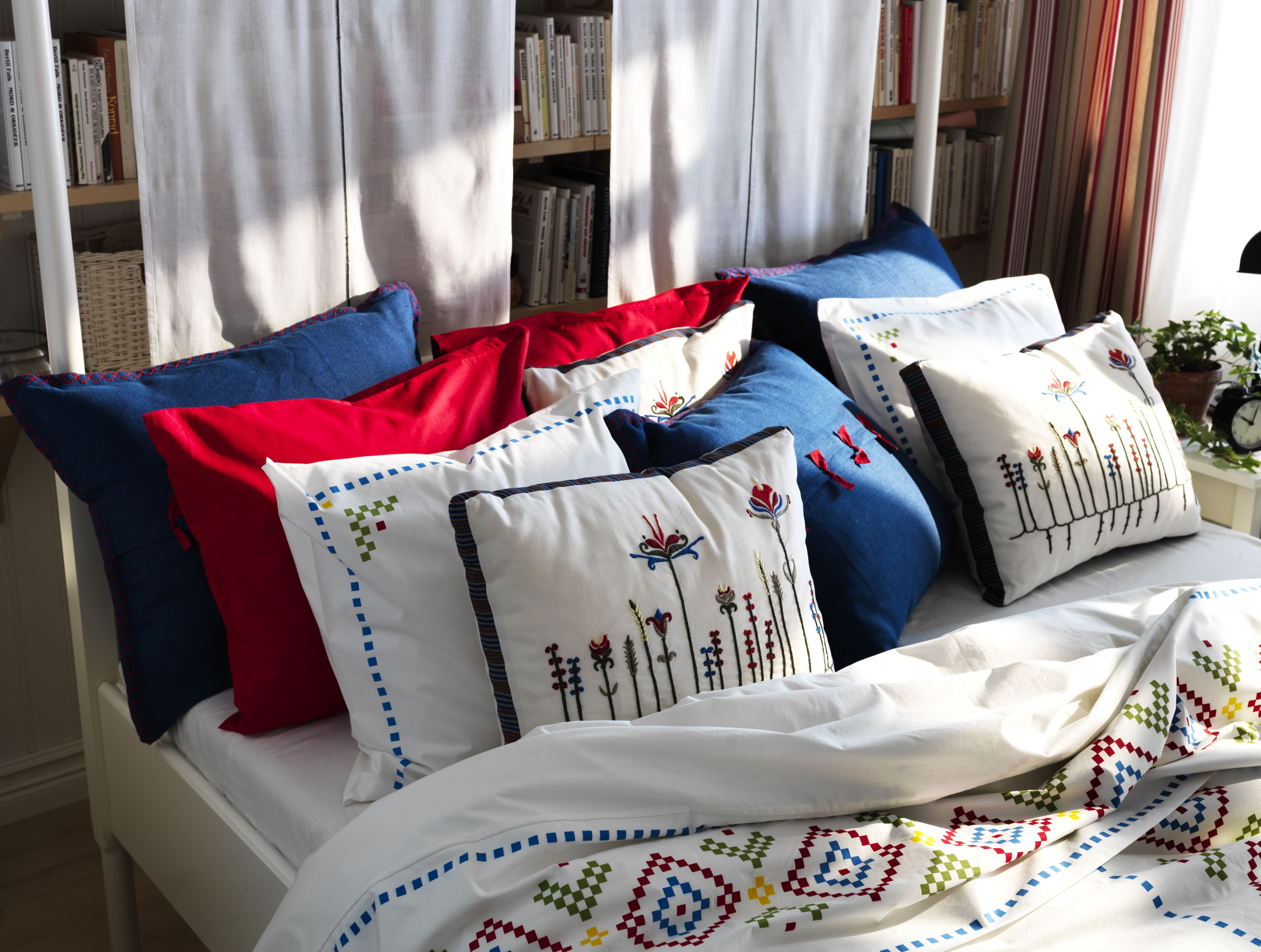The birgit cushion is embroidered with yarn in different colours
